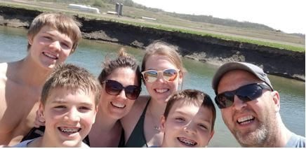 Selfie of our family at the river on a beautiful summer day