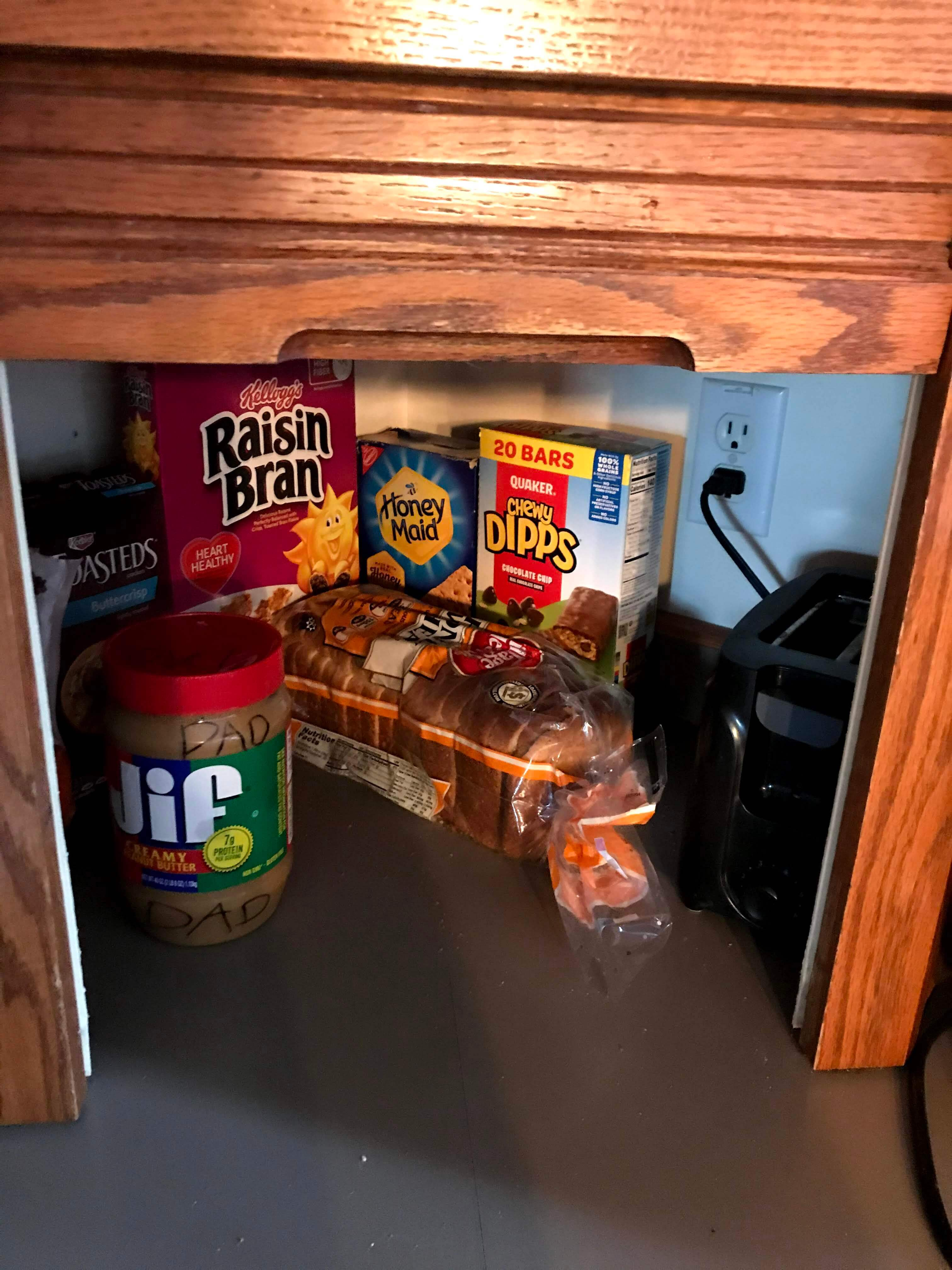 Our small corner kitchen cupboard with our small stash of gluten