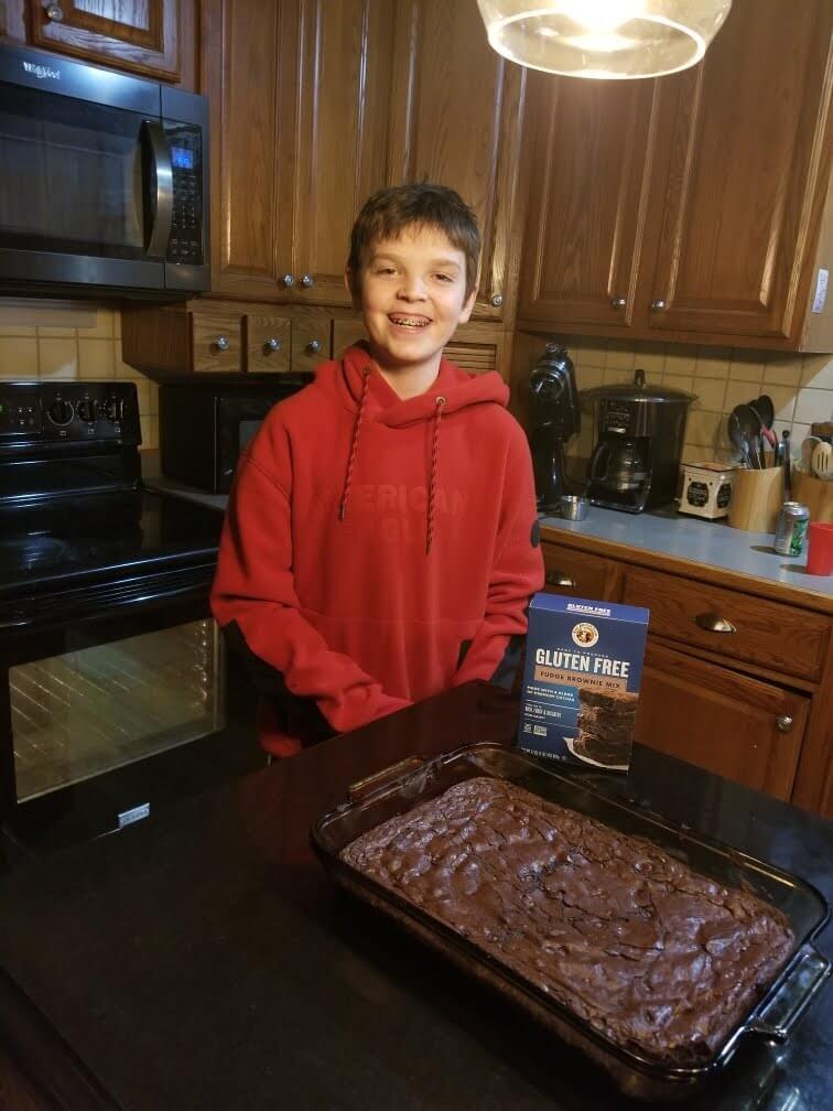 Boy with pan of gluten free King Arthur brownies
