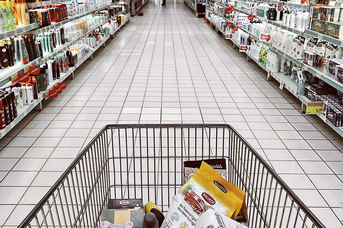 Cart moving down grocery store aisle