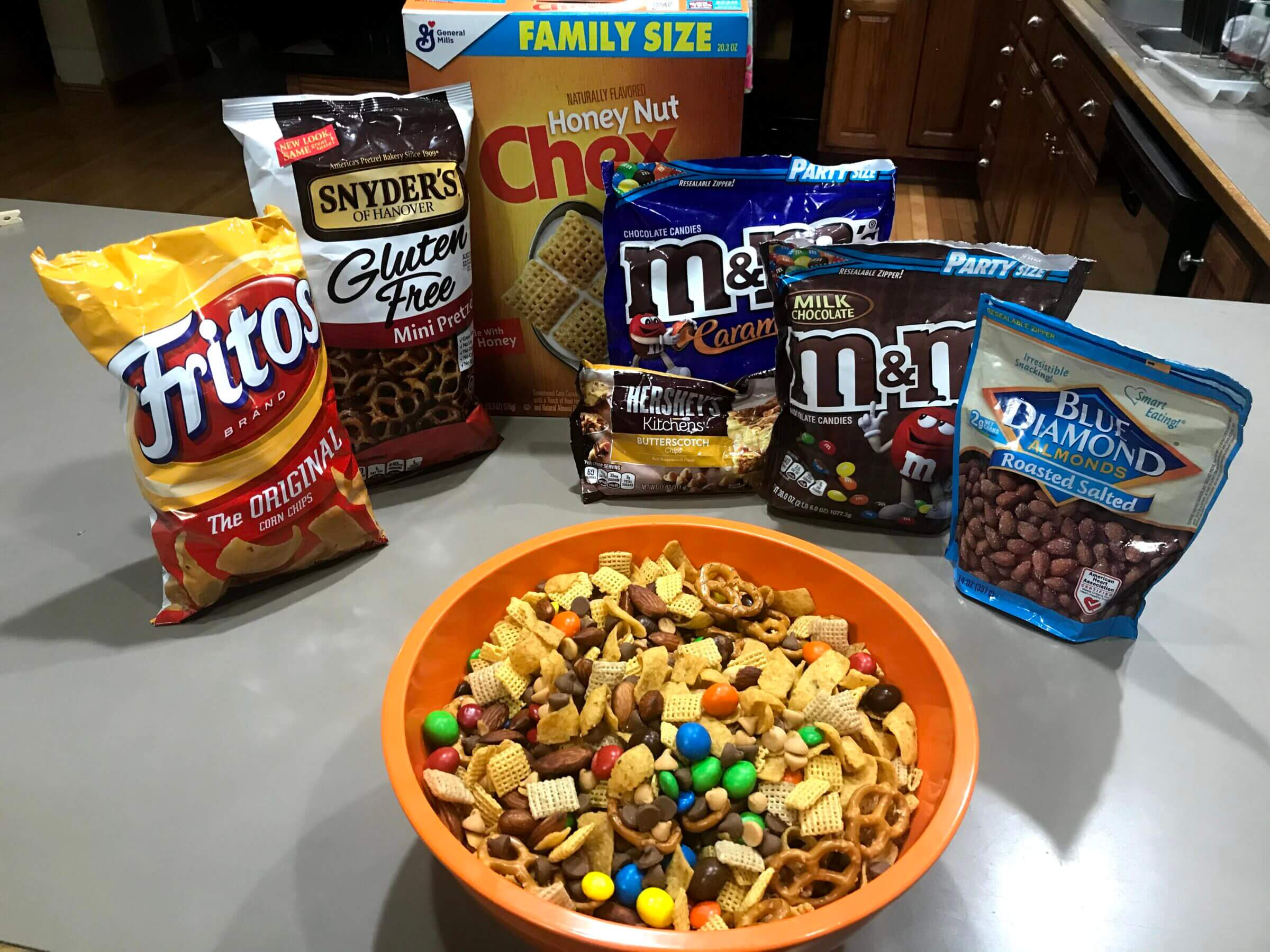 gluten free party mix in a bowl with ingredients