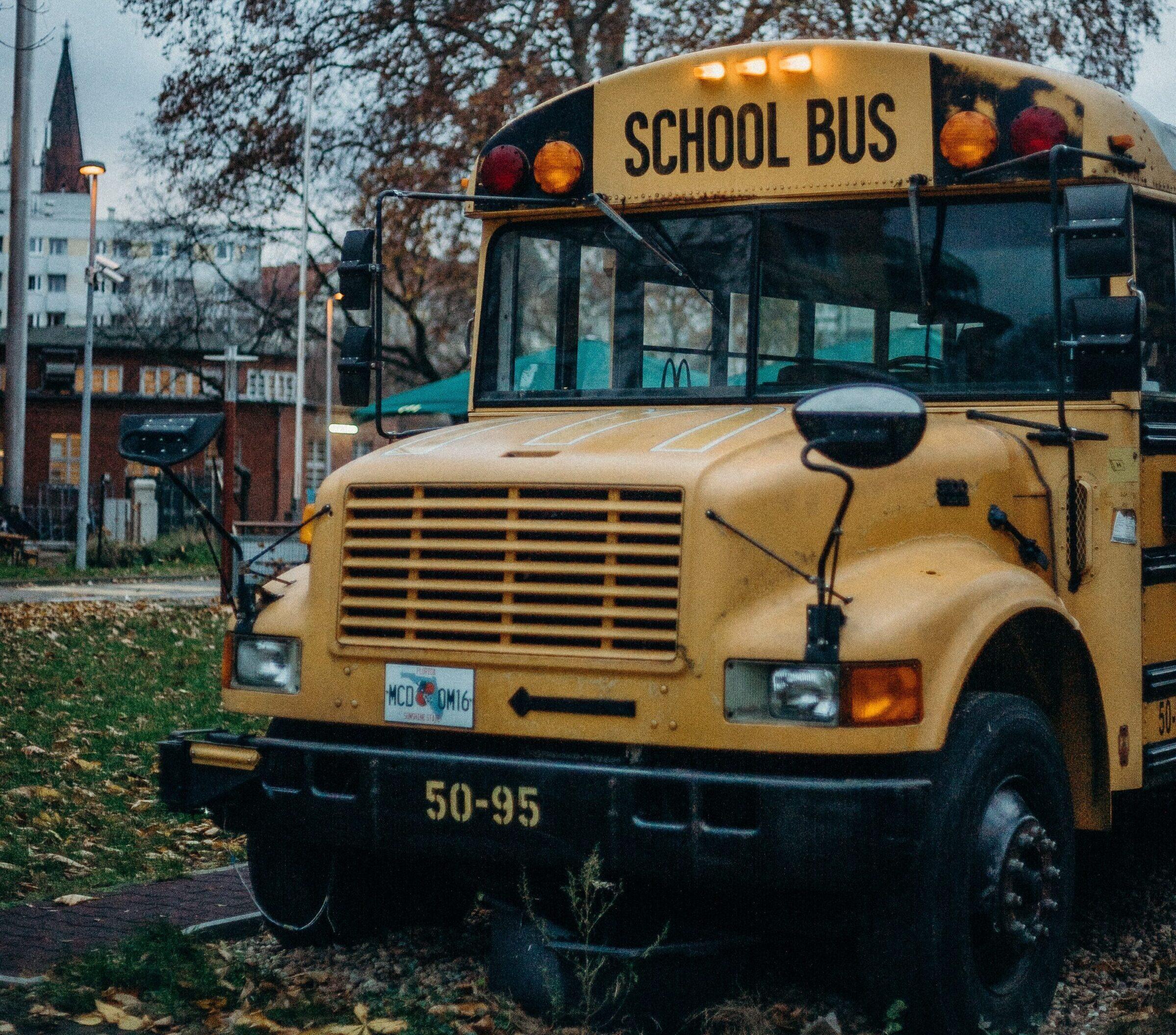 School bus parked by school