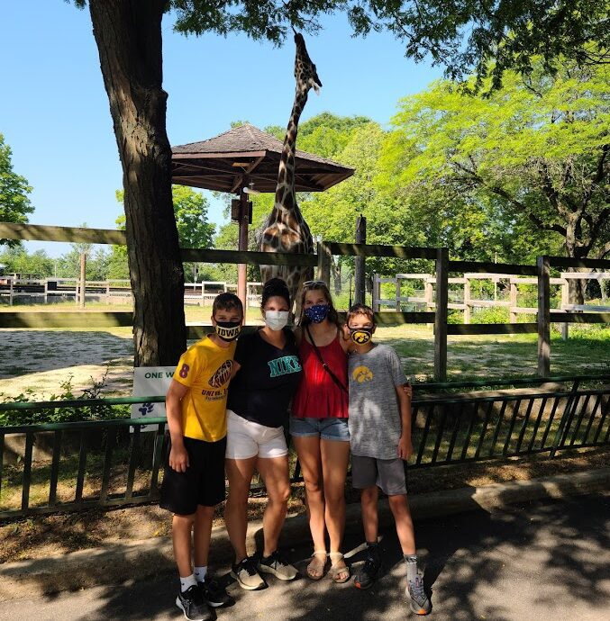 Our family at the Madison Zoo with Giraffe in background