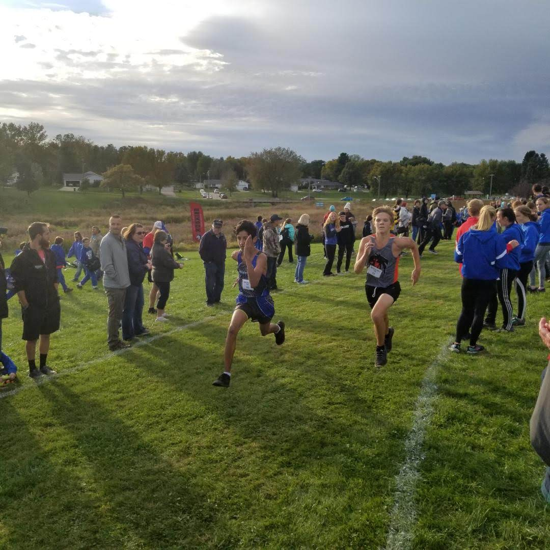 Connor running hard to finish line at out of town cross-country meet