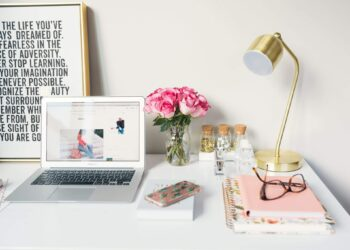 Desk with laptop, desk and other office essentials
