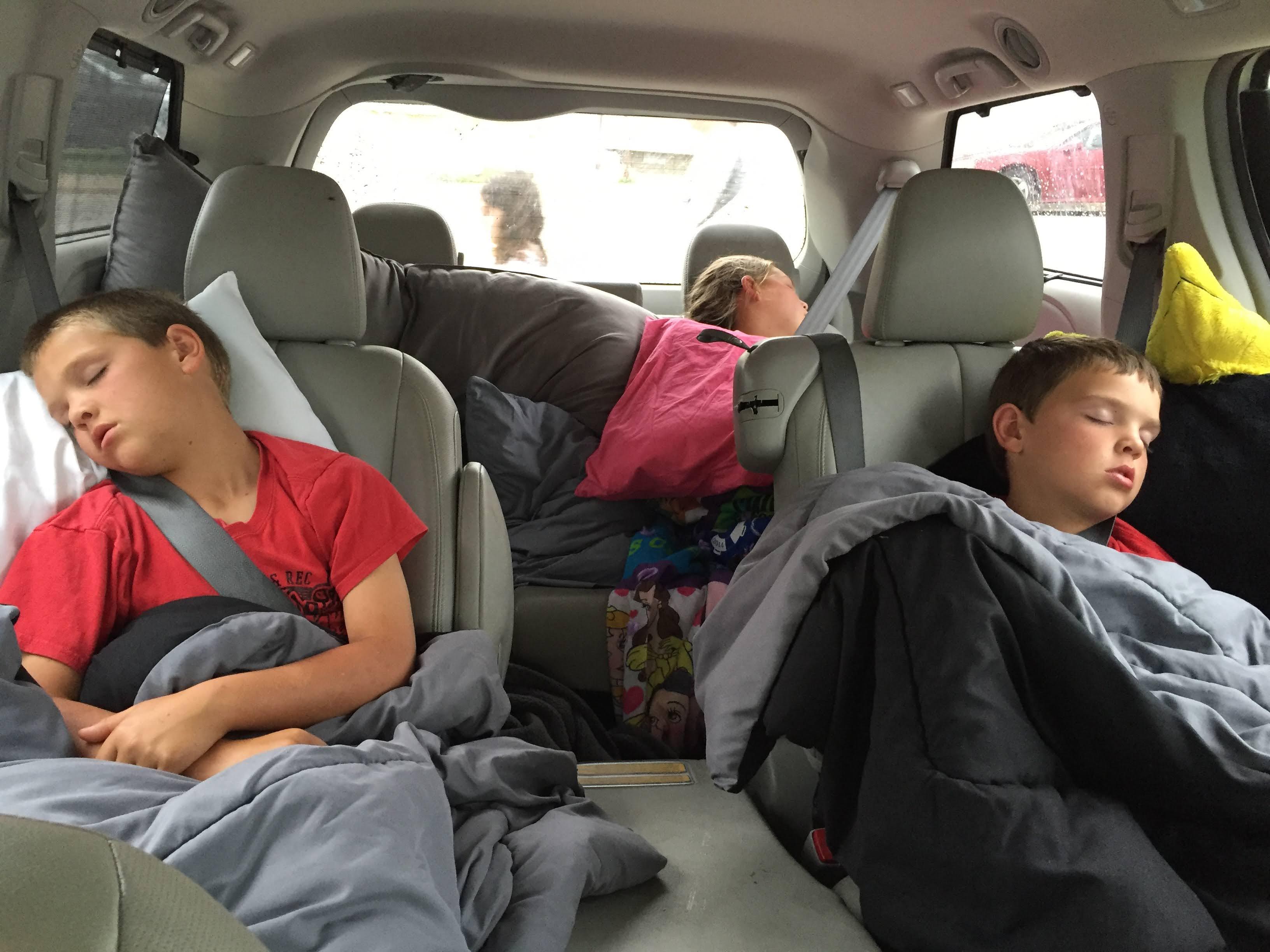 Stegen kids sleeping in the van as we travel